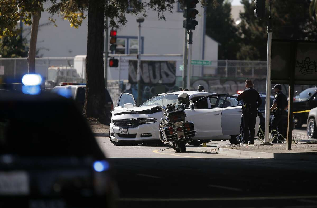 Oakland police investigate the scene of an officer involved shooting at the intersection of Martin Luther King and 27th after an armed robbery suspect was chased through Oakland streets and eventually shot, in Oakland, Calif., on Wed. August 12, 2015.