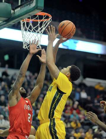 Javion Ogunyemi of Siena, right, puts up a shot during their game against Fairfield at the Times Union Center on Sunday, Jan. 11, 2015, in Albany, N.Y.   (Paul Buckowski / Times Union) Photo: Paul Buckowski / 00030029C