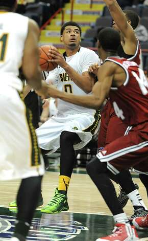 Siena's Javion Ogunyemi drives to the basket during a basketball game against Rider at the Times Union Center Monday, Feb. 2, 2015 in Albany, N.Y.  (Lori Van Buren / Times Union) Photo: Lori Van Buren / 00030380A