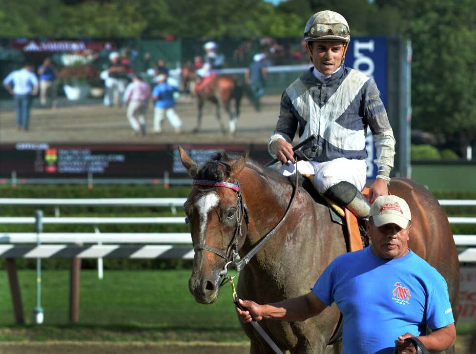 Tacticus with jockey Joel Rosario heads to the winner's circle after the 5th running of The Birdstone at the Saratoga Race Course Wednesday Aug. 12, 2015 in Saratoga Springs, New York. (Skip Dickstein/Times Union)