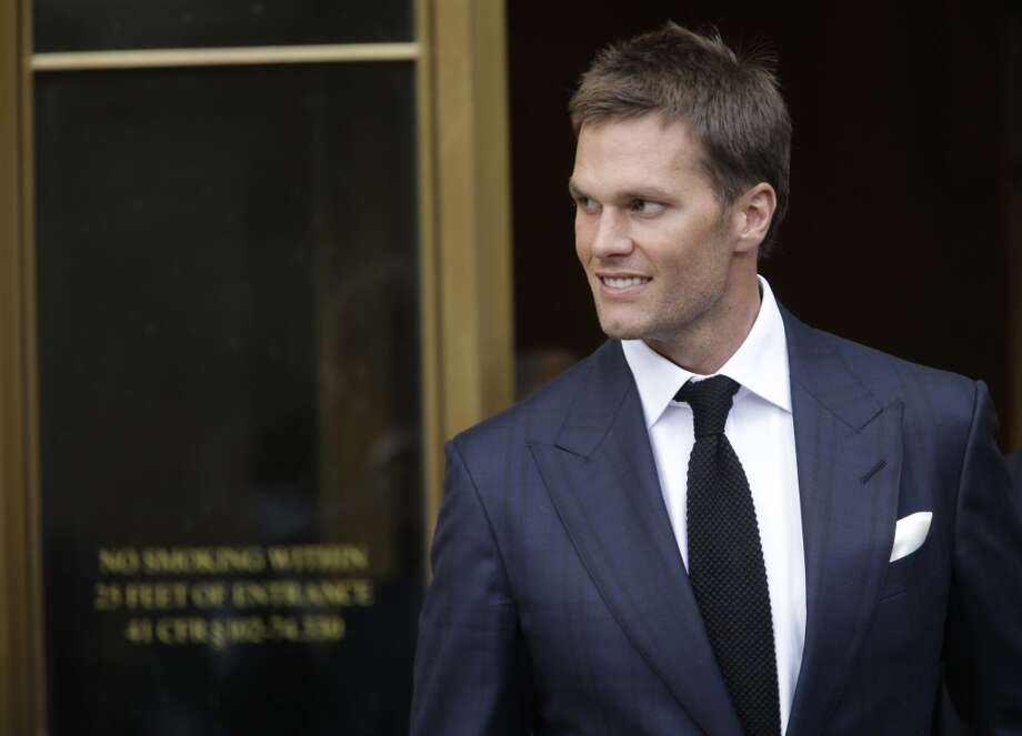 "Tom Brady leaves court after the hearing of Deflategate. The athlete has confirmed that he has a Donald Trump ""MAKE AMERICA GREAT AGAIN"" presidential campaign cap.Click through the slideshow to see the best memes following the court's ruling of Brady's role in Deflategate. Photo: Associated Press"