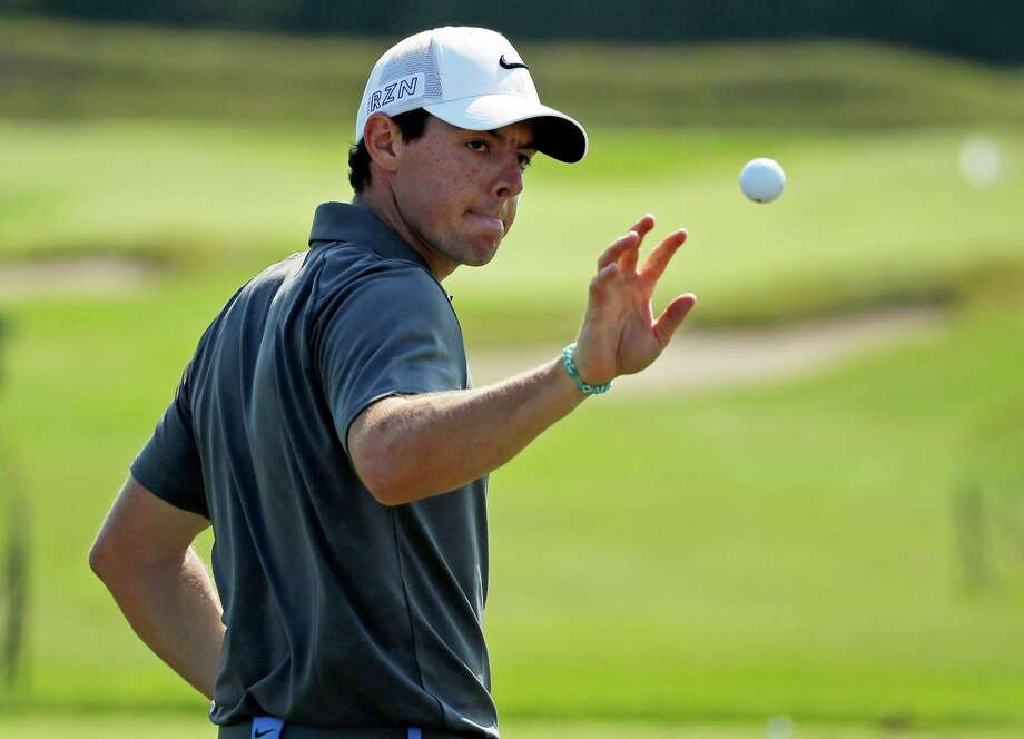 Rory McIlroy, of Northern Ireland, catches a ball on the range before a practice round for the PGA Championship golf tournament Wednesday, Aug. 12, 2015, at Whistling Straits in Haven, Wis. (AP Photo/Chris Carlson)  ORG XMIT: PGA188 Photo: Chris Carlson / AP