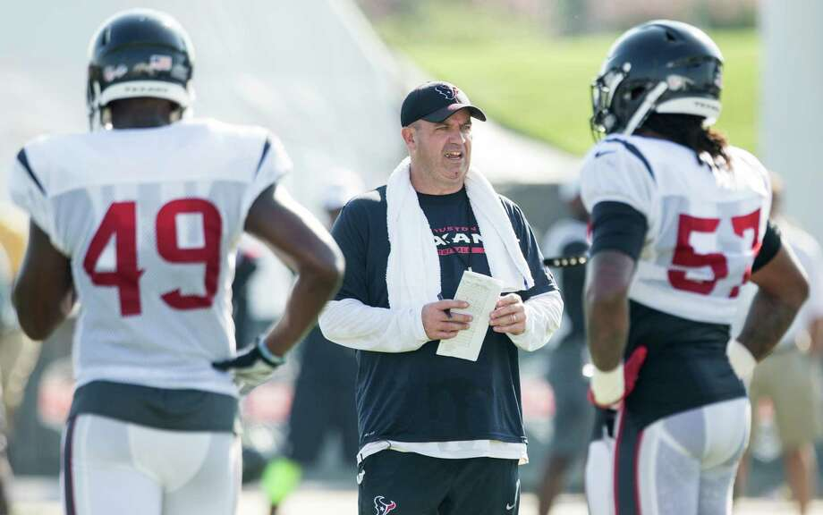 Houston Texans head coach Bill O'Brien watches over a drill during Texans training camp at the Methodist Training Center Wednesday, Aug. 12, 2015, in Houston. Photo: Brett Coomer /Houston Chronicle / © 2015 Houston Chronicle
