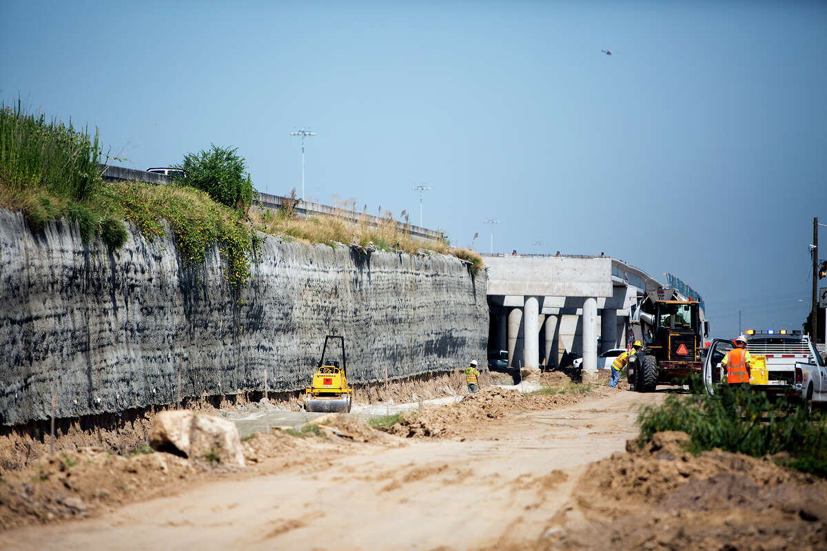 A crew works along U.S. 290 near Telge, Wednesday, Aug. 12, 2015, in Houston. TxDOT said the temporary relocation of a gas line and changes to the storm sewer system to accommodate Centerpoint Energy cost the project an additional $353,639. It's one of nearly 100 projects officials identified across Texas where delays or problems in relocating utilities cost the state $25 million in delay payments to contractors or lost time completing projects.