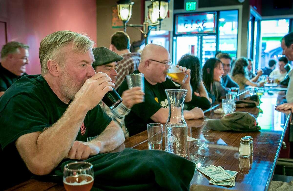 People have beers at Bel in San Francisco, Calif., on August 11th, 2015.
