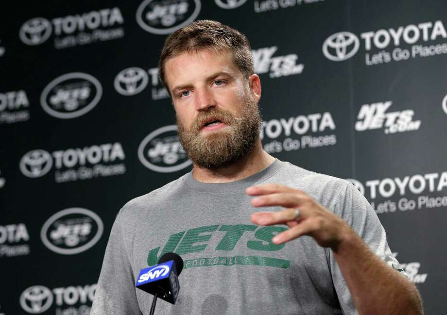 New York Jets quarterback Ryan Fitzpatrick speaks to reporters after NFL football practice in Florham Park, N.J., Tuesday, Aug. 11, 2015. Quarterback Geno Smith will be sidelined at least 6-10 weeks with a broken jaw after being punched by teammate Ikemefuna Enemkpali in the locker room Tuesday morning. Smith, entering his third season, required surgery to repair the injuries. (AP Photo/Seth Wenig) ORG XMIT: NJSW205 Photo: Seth Wenig / AP