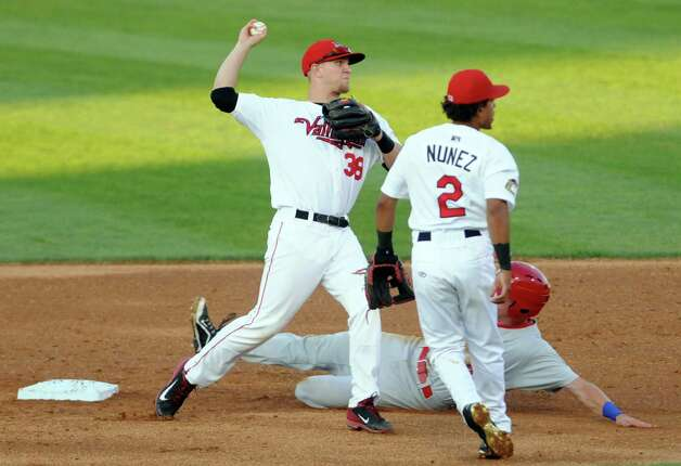 ValleyCats second baseman Kolbey Carpenter turns a double play during their game against the Auburn Doubledays at Joe Bruno Stadium on Wednesday Aug. 12, 2015 in Troy, N.Y. (Michael P. Farrell/Times Union) Photo: Michael P. Farrell / 10032902A