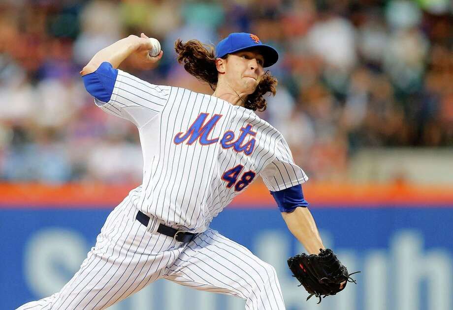 NEW YORK, NY - AUGUST 12:  Jacob deGrom #48 of the New York Mets pitches in the second inning against the Colorado Rockies at Citi Field on August 12, 2015 in the Flushing neighborhood of the Queens borough of New York City.  (Photo by Jim McIsaac/Getty Images) ORG XMIT: 538589481 Photo: Jim McIsaac / 2015 Getty Images