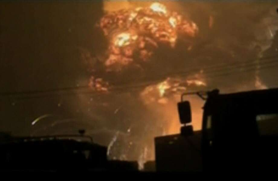 A screen grab from taken from state broadcaster China Central Television (CCTV) footage on August 12, 2015 shows a huge explosion in the northern Chinese port city of Tianjin. Photo: -, Handout / AFP / Getty Images / AFP