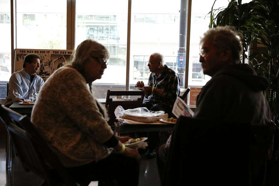 Scoop Nisker (left) chats with Jim Bunnell (second from right) as Selma Spector Vincent (second from left) chats with Arnie Passman at a private reception hosted at the Freight & Salvage Coffeehouse celebrating the 50th anniversary of the first issue of the Berkeley Barb, the local underground newspaper of the 1960s, on Wednesday, Aug. 12, 2015. Photo: Loren Elliott, The Chronicle