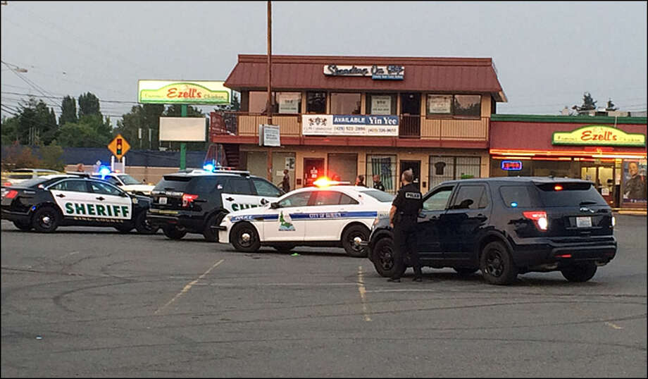 A 21-year-old man was killed outside the Skyway Ezell's restaurant Aug. 12. Two men turned themselves in to the King County Sheriff's Office Monday morning in connection with the slaying.