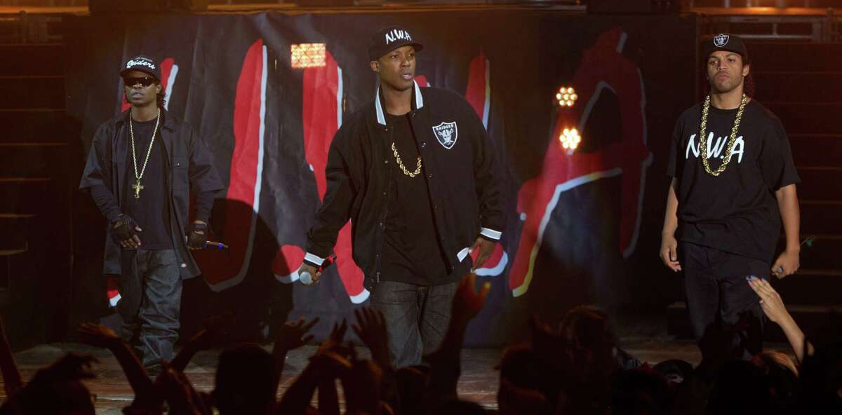 """This photo provided by Universal Pictures shows, Jason Mitchell, from left, as Eazy-E, Corey Hawkins as Dr. Dre, and O'Shea Jackson, Jr. as Ice Cube, in the film, """"Straight Outta Compton."""" The movie releases in U.S. theaters on Aug. 14, 2015. (Jaimie Trueblood/Universal Pictures via AP)"""