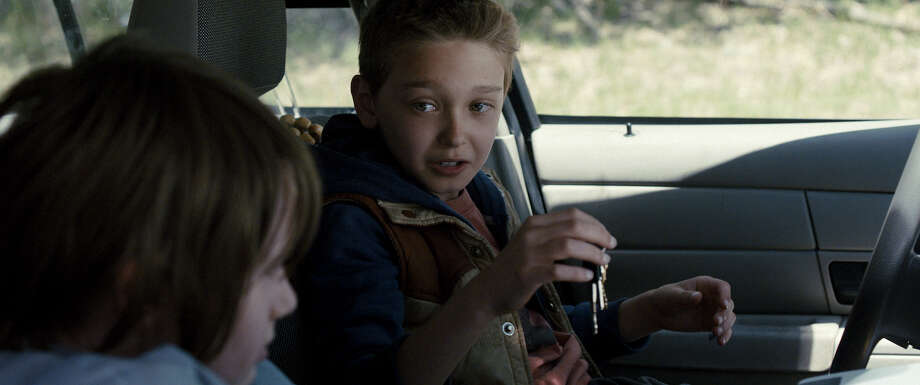 Hays Wellford (left) and James Freedson-Jackson (right) play a pair of rebellious boys who take the Sheriffés car for a dangerous joy ride in COP CAR, directed by Jon Watts.