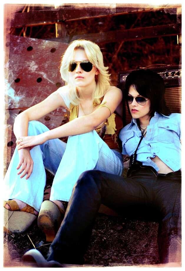 "Dakota Fanning, left, and Kristen Stewart are Cherie Currie and Joan Jett, respectively, in ""The Runaways."" Photo: David Moir, HO / Apparition Films"