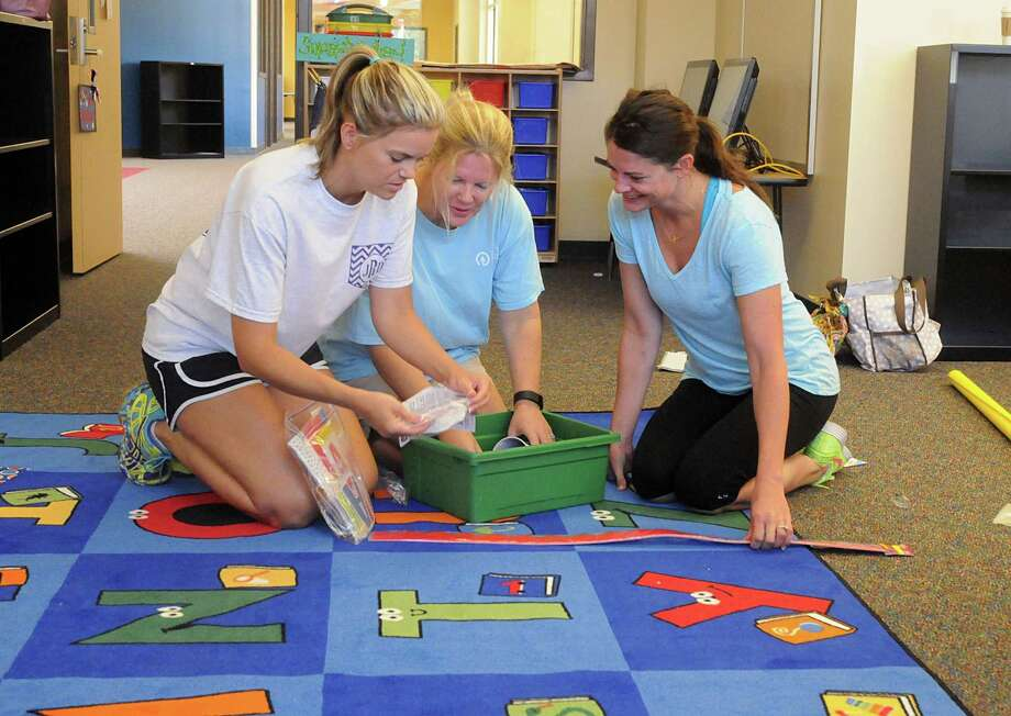 Kindergarten teachers Jennifer Robison, Jenn Wolford, and Britni Wood set up Wood's classroom  in French Elementary, the new Klein ISD school, 5802 West Rayford in Spring. Photograph by David Hopper. Photo: David Hopper, Freelance / freelance