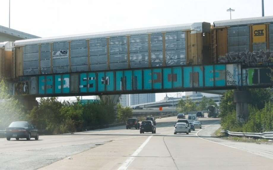"For the third time in a week, motorists on Interstate 45 found the  infamous ""Be Someone"" graffiti sign altered. (Cody Duty / Houston Chronicle) Photo: Cody Duty, Houston Chronicle"