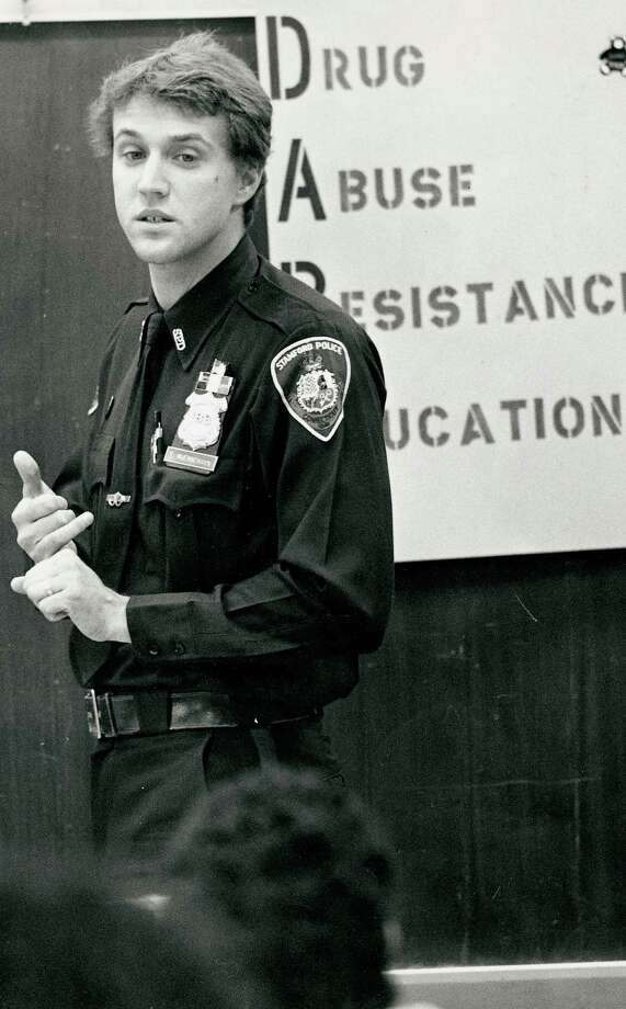 Stamford Police officer Tom Wuennemann talks with students as part of DARE, a national drug abuse education program, at Julia A. Stark School in Stamford, 1989. Wuennemann was promoted to assistant chief of the Stamford police department on Aug. 12, 2015. Photo: File Photo / Stamford Advocate File