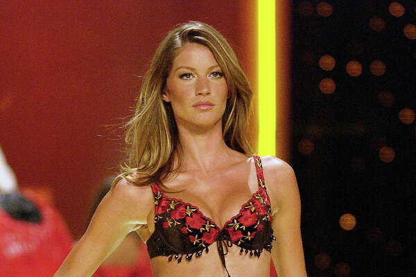 NEW YORK, USA - NOVEMBER 14: Gisele Bundchen during 8th Annual Victoria's Secret Fashion Show - Runway at The New York State Armory on November 14, 2002 in New York City, New York, United States.