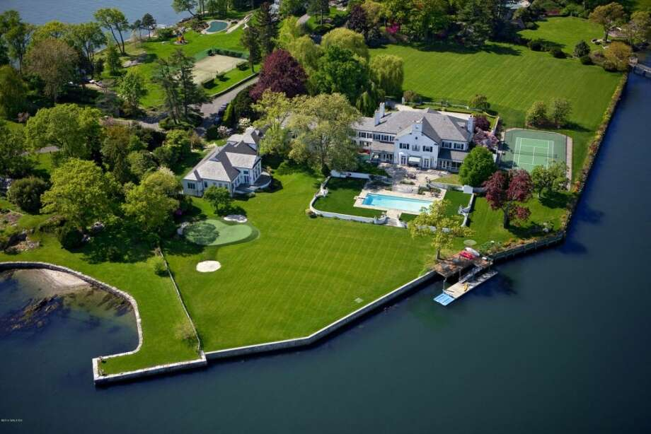 The former weekend home of real estate mogul Donald Trump is on the market for $54 million. Located in Greenwich, Connecticut, the six-acre estate holds a ginormous 19,773-square-foot home with eight bedrooms and 11.5 bathrooms, according to Zillow. Photo: Courtesy, Zillow
