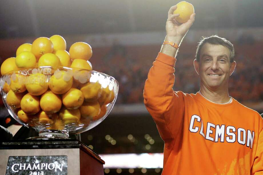 Clemson head coach Dabo Swinney throws oranges into the crowd as he celebrates after Clemson defeated Ohio State 40-3 in the Orange Bowl NCAA college football game, Saturday, Jan. 4, 2014, in Miami Gardens, Fla. Photo: Wilfredo Lee /Associated Press / AP