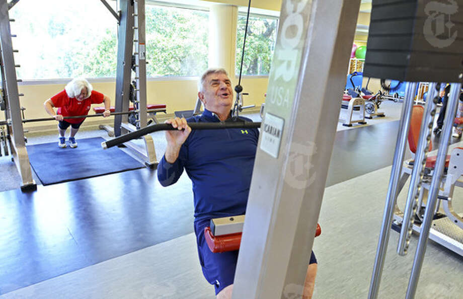 Linda and Vince Ferrigno go through their workout routine at the Wolfson Wellness Center in Jacksonville, Fla. According to the International Health Racquet & Sports Club Association, people age 55 and over are the fastest-growing membership segment for the health club industry. Photo: New York Times News Service / New York Times New Service