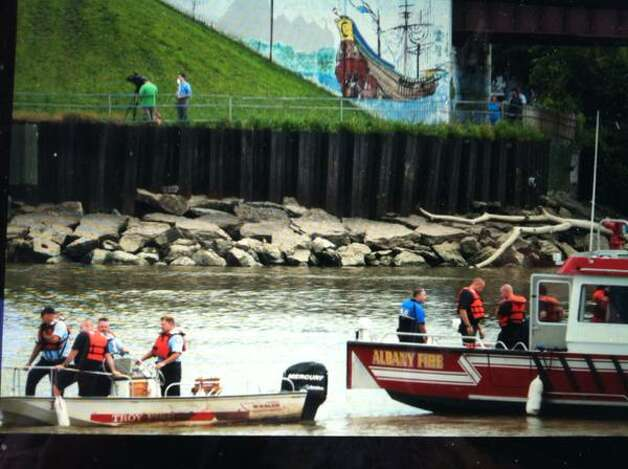 Rescue workers on boats in the Hudson River monitor a man sitting on the rail of the Dunn Memorial Bridge between Albany and Rensselaer on Thursday, Aug. 13, 2015. (Michael P. Farrell/Times Union)