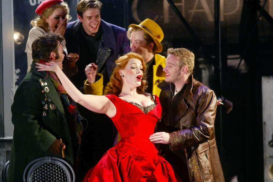 The red cast of Baz Luhrmann's La Boheme during the MOMUS scene.  Photo: Mike Kepka, SFC