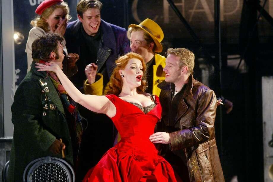 The red cast of Baz Luhrmann's La Boheme during the MOMUS scene. Photo: Mike Kepka, SFC