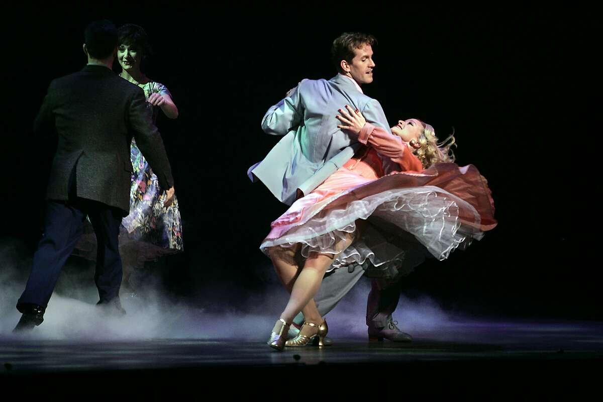 """Irving Berlin's """"White Christmas,"""" a new musical at the Curran Theatre. Jeffry Denman playing Phil Davis dancing with Meredith Patterson."""
