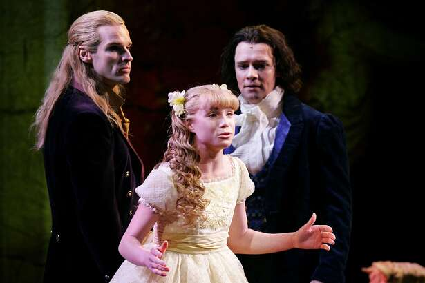 "lestat10_0007_db.jpg Allison Fischer as Claudia, sings as Hugh Panaro as Lestat, left, and Jim Stanek as Louis, watch, in the second act of ""Lestat,"" a new musical at the Curran theatre. Event on 1/7/06 in San Francisco. Darryl Bush / The Chronicle"