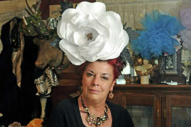 British-born Maurita Smith makes gorgeous hats, a skill she picked up while recovering from a traumatic injury on Wednesday Aug. 5, 2015 in Fort Johnson, N.Y. (Michael P. Farrell/Times Union) Photo: Michael P. Farrell / 10032863A