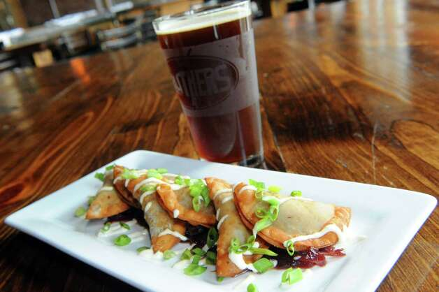 Crispy short rib dumplings at Druthers Brewing on Thursday Aug. 6, 2015 in Albany, N.Y. (Michael P. Farrell/Times Union) Photo: Michael P. Farrell / 10032919A