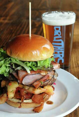 Spicy island burger at Druthers Brewing on Thursday Aug. 6, 2015 in Albany, N.Y. (Michael P. Farrell/Times Union) Photo: Michael P. Farrell / 10032919A