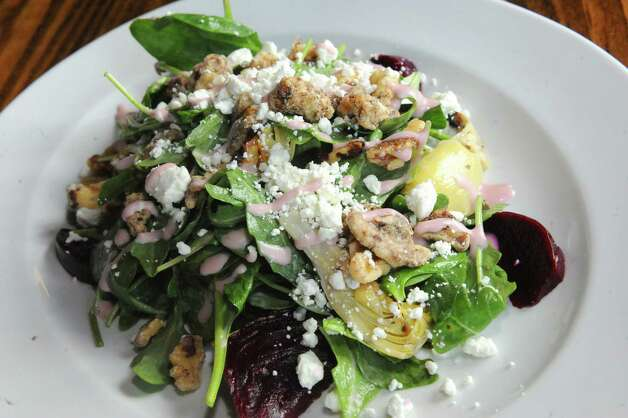 Roasted beet salad at Druthers Brewing on Thursday Aug. 6, 2015 in Albany, N.Y. (Michael P. Farrell/Times Union) Photo: Michael P. Farrell / 10032919A