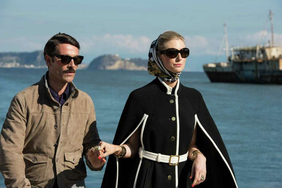 """This photo provided by Warner Bros. Pictures shows, Luca Calvani, left, as Alexander and Elizabeth Debicki, right, as Victoria in Warner Bros. Pictures' action adventure """"The Man from U.N.C.L.E.,"""" a Warner Bros. Pictures release. The movie opens Aug. 14, 2015. (Daniel Smith/Warner Bros. Pictures via AP) ORG XMIT: CAET643 Photo: Daniel Smith / Warner Bros. Pictures"""