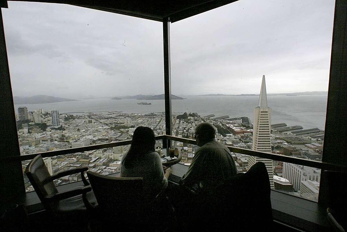 BARCAR_034_ls.jpg From left: Janice Hallstrom and Justin Hallstrom (husband and wife), of Woodbridge, enjoy the view from the Carnelian Room on a visit to San Francisco. Cocktails via cable cars. We go to the view lounges (Harry Denton's Starlight Room, the Carnelian Room, Mark Hopkins and the Grandviews on 4/27/03 in San Francisco. LEA SUZUKI/The Chronicle