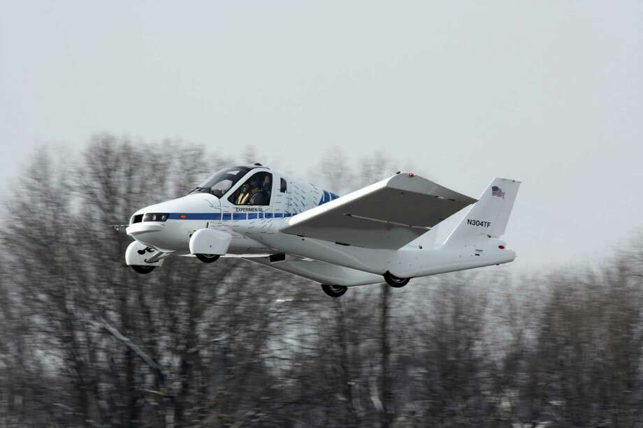 Transition, a flying car, taking off from Lawrence Municipal Airport in Massachusetts. (Terrafugia Inc.) Photo: Picasa