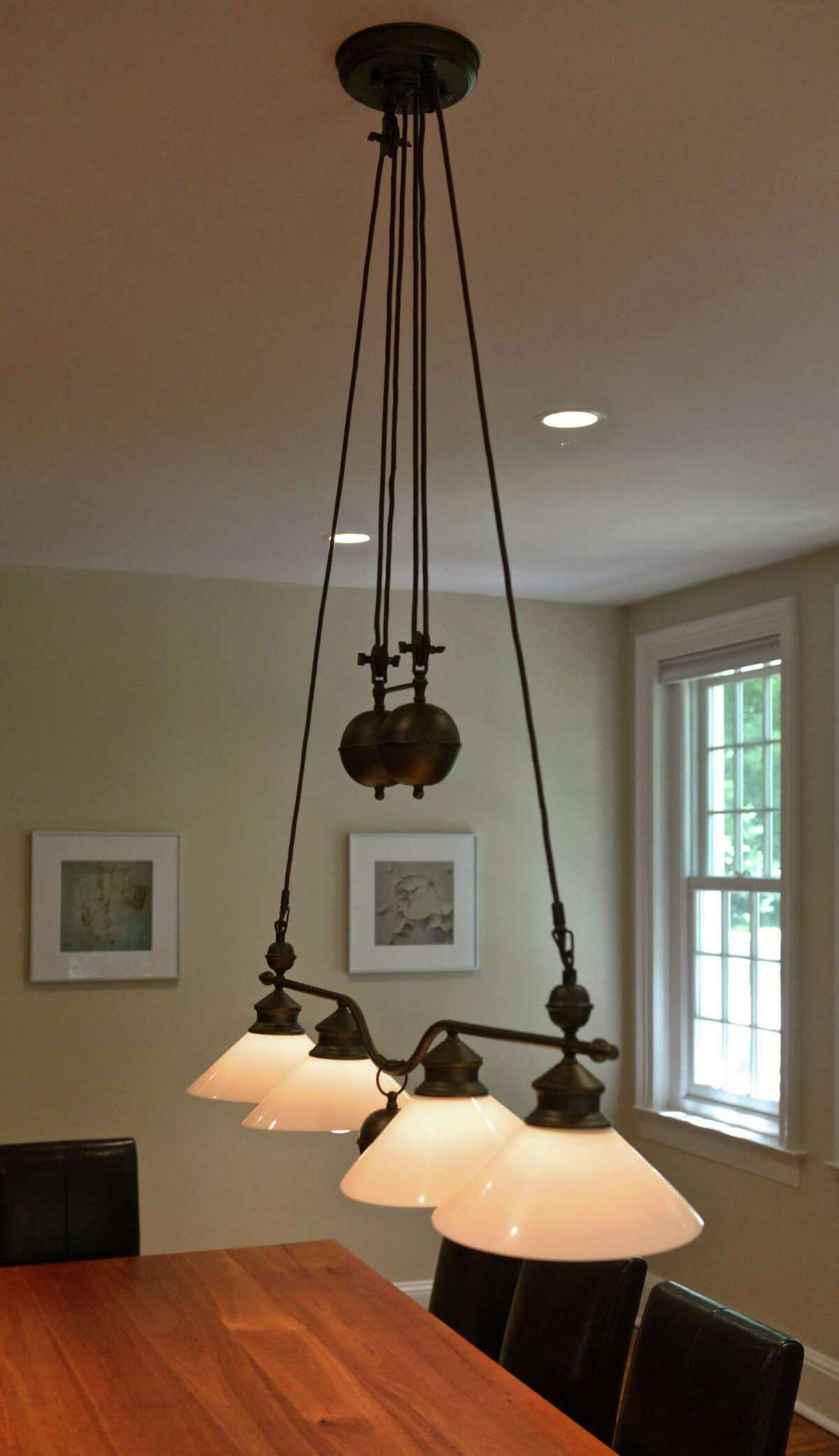 A light in a conference room at 5 Booth House Lane, a unique office building available in New Milford, Conn, that is an 1812 brick colonial that was recently restored by its owner, Joe Mammano. Thursday, August 13, 2015.