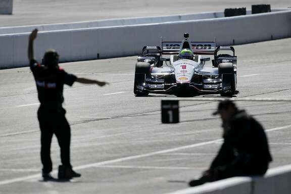 The pit crew brings in a car driven for Team Penske on a day of testing Thursday August 13, 2015. Testing day at Sonoma Raceway for some of the IndyCar drivers getting set for the GoPro Grand Prix of Sonoma at the end of August.