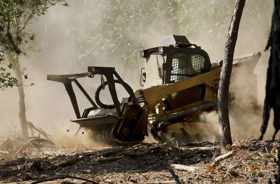 Darrel Pachin drives the water district's new skid steer machine, which mulches everything in its path. Photo: Michael Macor, The Chronicle