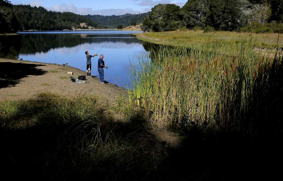 Grant Edgerton, 13 fishes with his grandfather Bill Foehr at Bon Tempe reservoir near where the Marin Municipal Water District is reducing the wildland fire threat by removing heavy brush iand trees n their watershed, in Fairfax, Calif., as seen on Thurs. August 13, 2015. Photo: Michael Macor, The Chronicle