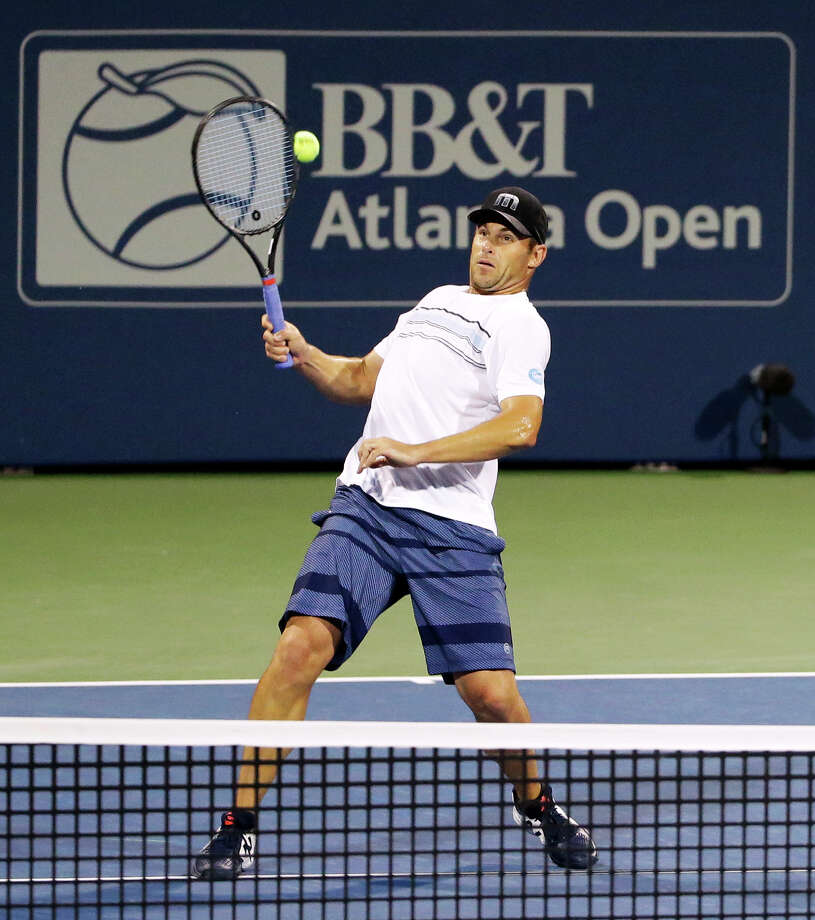 Andy Roddick returns a shot during the first set of a first round doubles match with partner Mardy Fish against Yen-Hsun Lu and Jonathan Marray at the Atlanta Open tennis tournament Wednesday, July 29, 2015, in Atlanta. Roddick and Fish won 7-6, 6-4. (AP Photo/David Goldman) Photo: David Goldman / Associated Press / AP