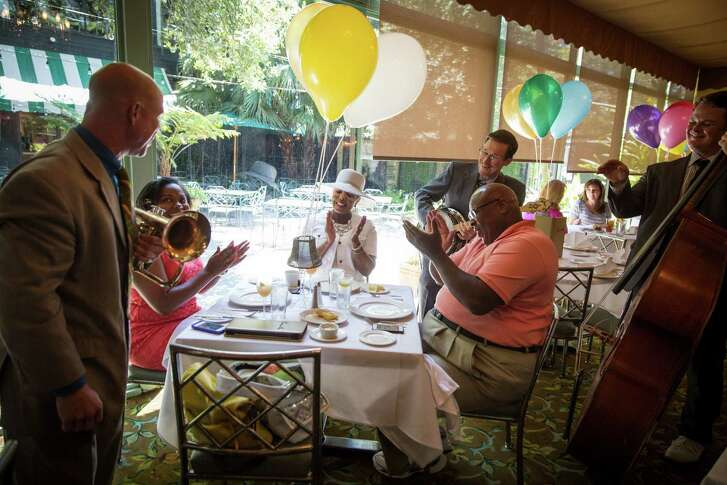 L-R, seated: Lauren Harper, 25, parents Rocklyn Harper, 58, and Howard Harper, 65, all of Houston, enjoy a jazz brunch at Commanders Palace in New Orleans on August 2, 2015.