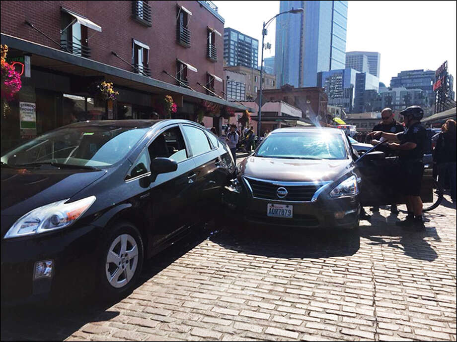 A driver hit three cars and one pedestrian on Pike Place Thursday morning while his foot was reportedly caught beneath one of his pedals. The pedestrian suffered a minor head injury. Photo: KOMO