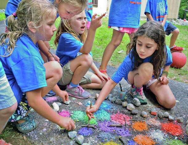 Campers grind up colored chalk for hand painting at Camp Northwoods, a summer day camp held on Skidmore College's Campus Thursday August 13, 2015 in Saratoga Springs, NY.  (John Carl D'Annibale / Times Union) Photo: John Carl D'Annibale / 00032744A