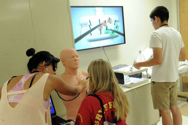 Middle school students going to a camp at the College of St. Rose got some experience with doctors' tools and medical technology at the Albany Medical Center's Simulation Lab on Thursday Aug. 13, 2015 in Albany, N.Y. (Michael P. Farrell/Times Union) Photo: Michael P. Farrell / 00032991A