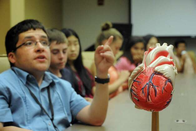 Fourteen-year-old Pete Tedeschi, left, of East Greenbush ask a question as middle school students going to a camp at the College of St. Rose got some experience with doctors' tools and medical technology at the Albany Medical Center's Simulation Lab on Thursday Aug. 13, 2015 in Albany, N.Y. (Michael P. Farrell/Times Union) Photo: Michael P. Farrell / 00032991A