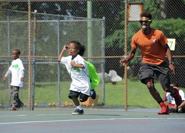 YMCA counselor Antonio Randolph chases Kiymar Nobles, 5, of Albany in a game of Pac-Man during the 15-LOVE program at this yearOs Jamboree in Washington Park on Thursday, Aug. 13, 2015 in Albany, N.Y.  (Lori Van Buren / Times Union) Photo: Lori Van Buren / 00032989A