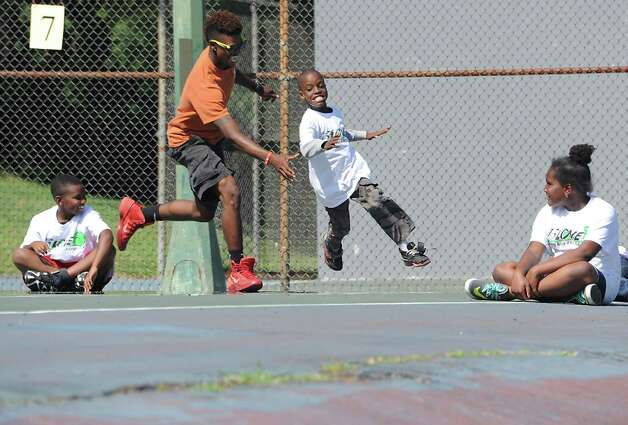 YMCA counselor Antonio Randolph chases Kyel Taylor, 9, of Albany in a game of Pac-Man during the 15-LOVE program at this yearOs Jamboree in Washington Park on Thursday, Aug. 13, 2015 in Albany, N.Y.  (Lori Van Buren / Times Union) Photo: Lori Van Buren / 00032989A