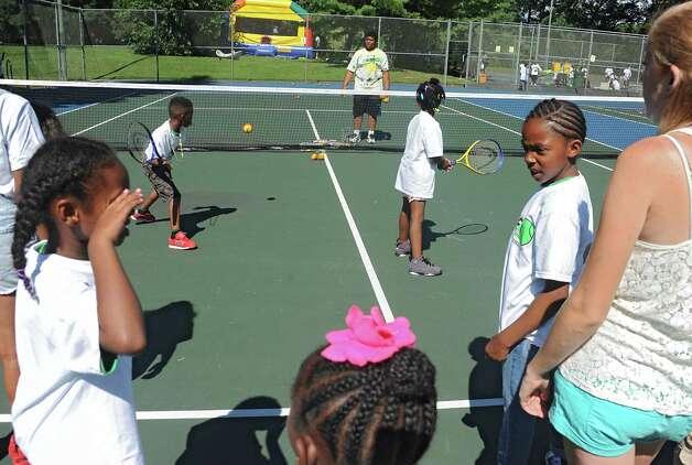 Participants in the 15-LOVE program practice their tennis swing at this yearOs Jamboree in Washington Park on Thursday, Aug. 13, 2015 in Albany, N.Y.  (Lori Van Buren / Times Union) Photo: Lori Van Buren / 00032989A